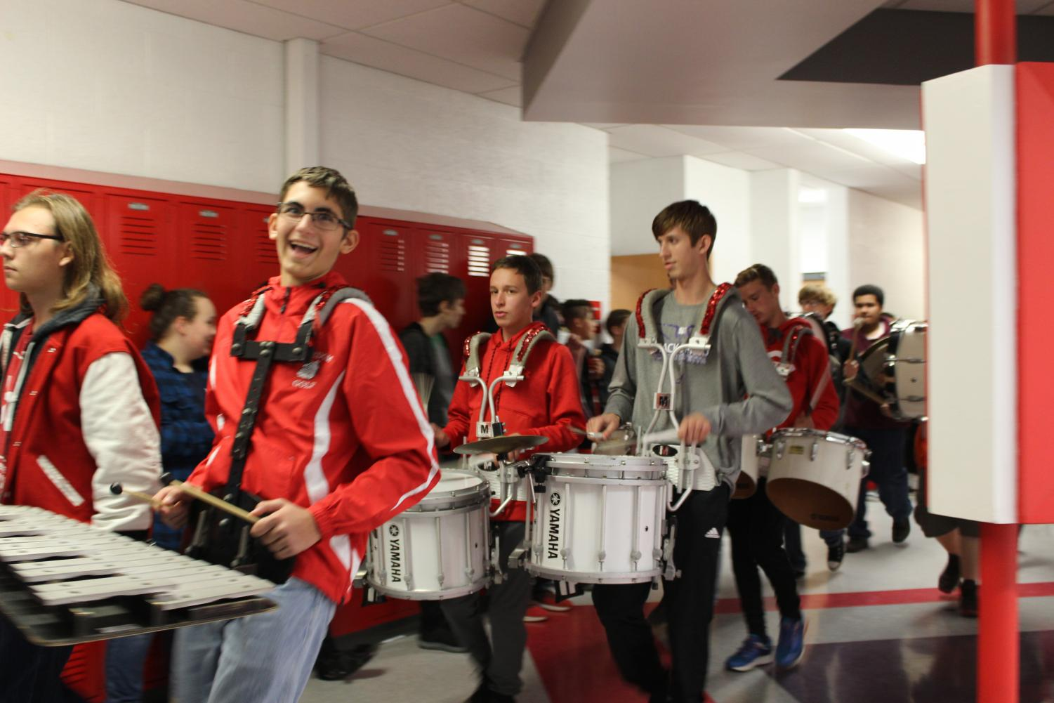 Members of the Freedom Big Red Marching Band accompany the football and soccer players during the Pep Parade through Freedom Middle School on Nov. 2.