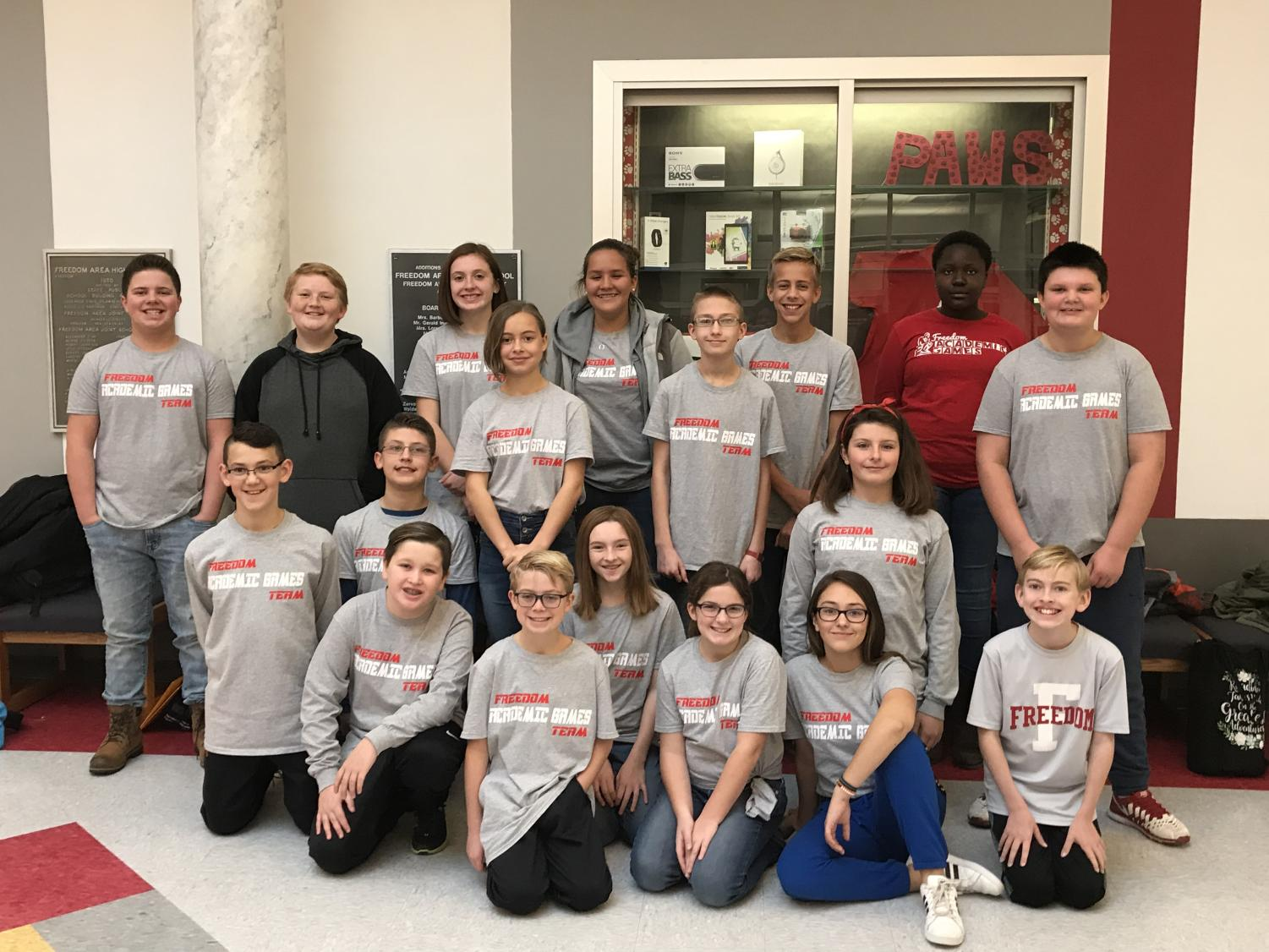 The Freedom Middle School Academic Games team waits in the lobby for their bus before departing for the Propaganda competition at Geneva College on Nov. 15.