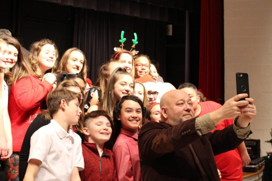 Mr.+Keith+Kovalic%2C+choir+director%2C+takes+a+selfie+with+members+of+the+choir+during+their+concert+on+Dec.+12+at+Freedom+Middle+School.