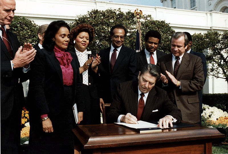40th President, Ronald Regan, signs the bill commemorating Martin Luther King Jr.'s birthday as a federal holiday on Nov. 2, 1983 in the White House Garden.