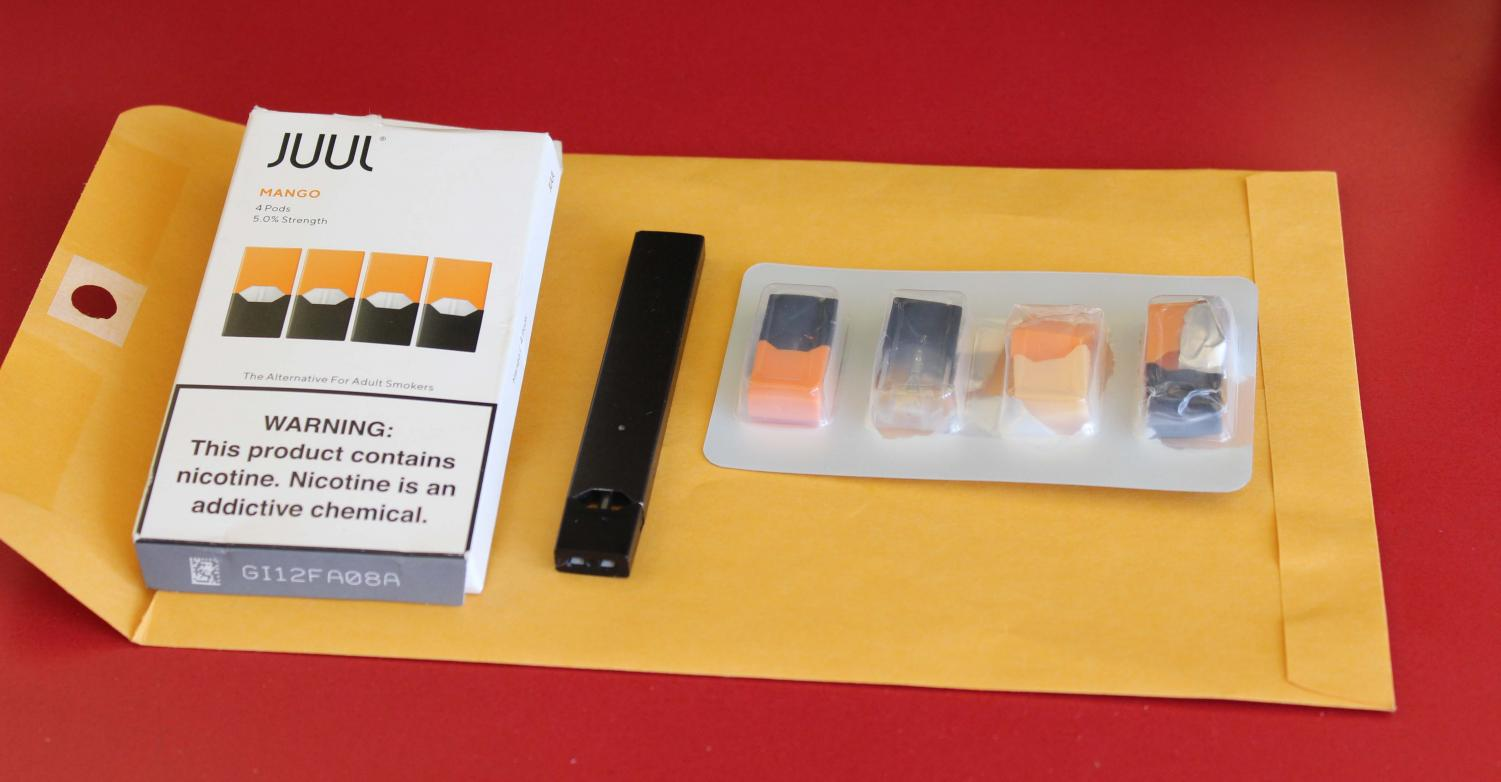 A Juul device and mango flavored pods are shown above.  Juuls are illegal to purchase if under 18, but vaping has become an increased problem in schools.