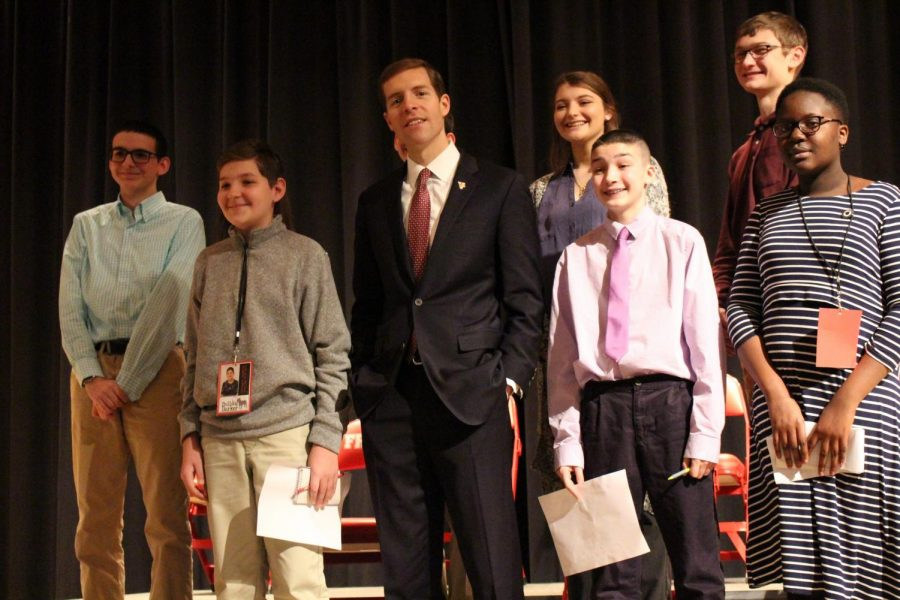 Bulldog Barker staff members Dylan Scheel, Christopher Denkovich, and Joanna Odebode, as well as FHS Press members Cade Skuse, Jenna Engel, and  Keith Pawlowski, stand next to Conor Lamb on Monday, March 4 in the high school auditorium.