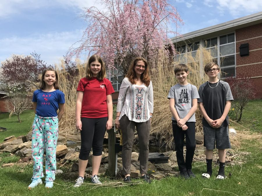 Ging and sixth grade students in the courtyard during a spring afternoon. The currently underused courtyard will be transformed this fall into an outdoor learning space.