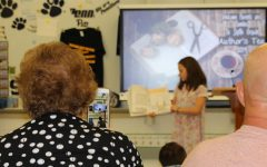 Sixth graders share their children's books to parents during Authors Tea