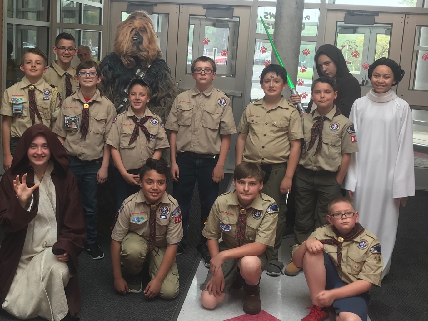 The new Boy Scouts pose for a picture with Star Wars characters in the Freedom Middle School lobby at the Blue and Gold Banquet on May 4.