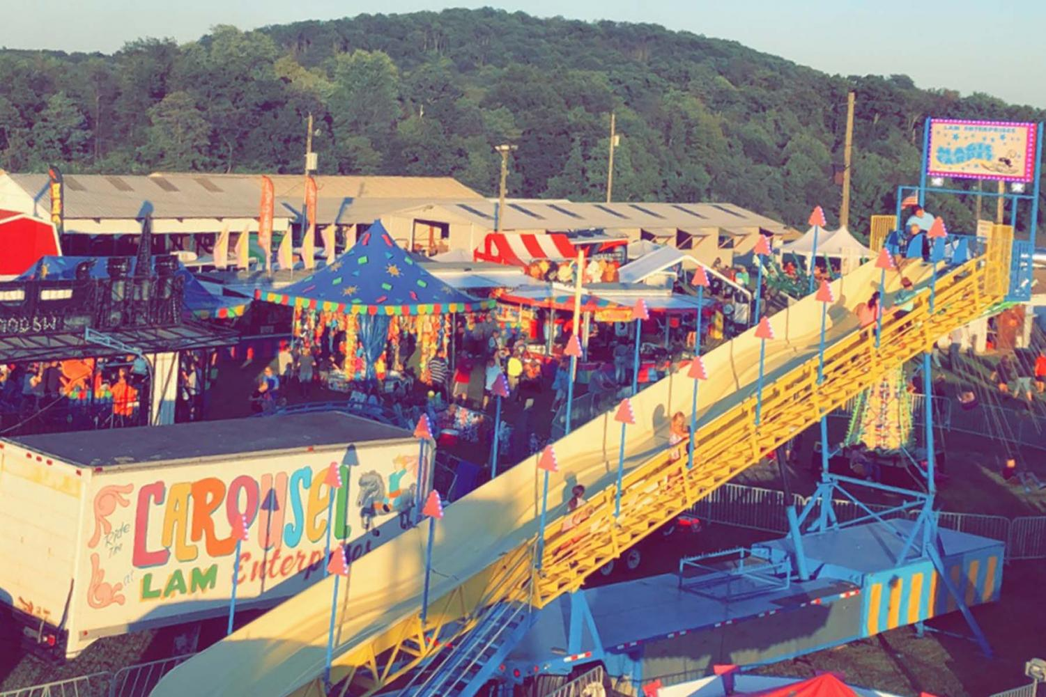 The sun sets on the Big Knob Grange Fair as viewed from the Ferris Wheel.