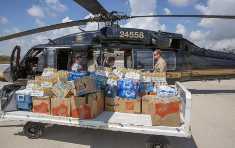 : Customs and Border Protection agents deliver food and water to severely damaged Fox Town on the Abaco Islands in the Bahamas, in the aftermath of Hurricane Dorian on Sept. 6 2019.