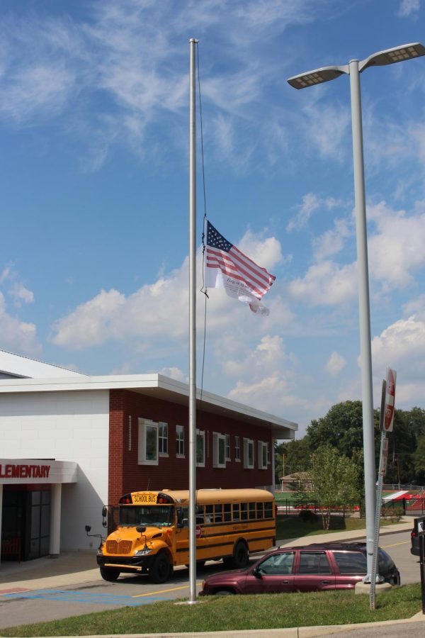 The Flag of Honor flies at half-staff outside of Freedom Elementary School on 9/11.