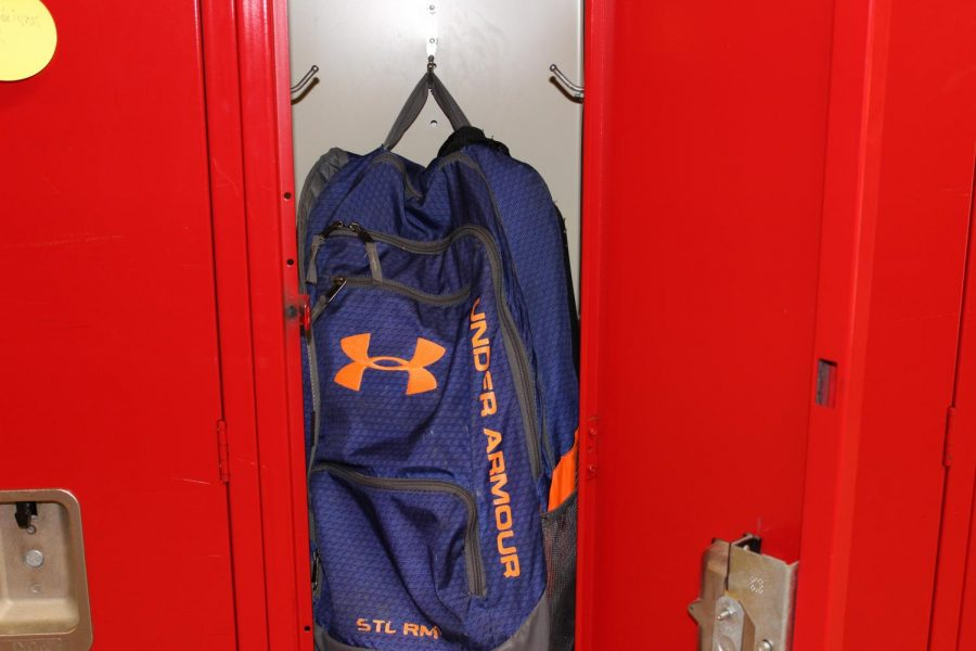 After the new rule about backpacks was put into place, the backpack sits alone in a locker.