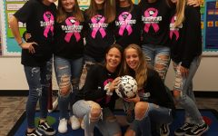 Eighth-grade girl's soccer team meets with kindergarten classes