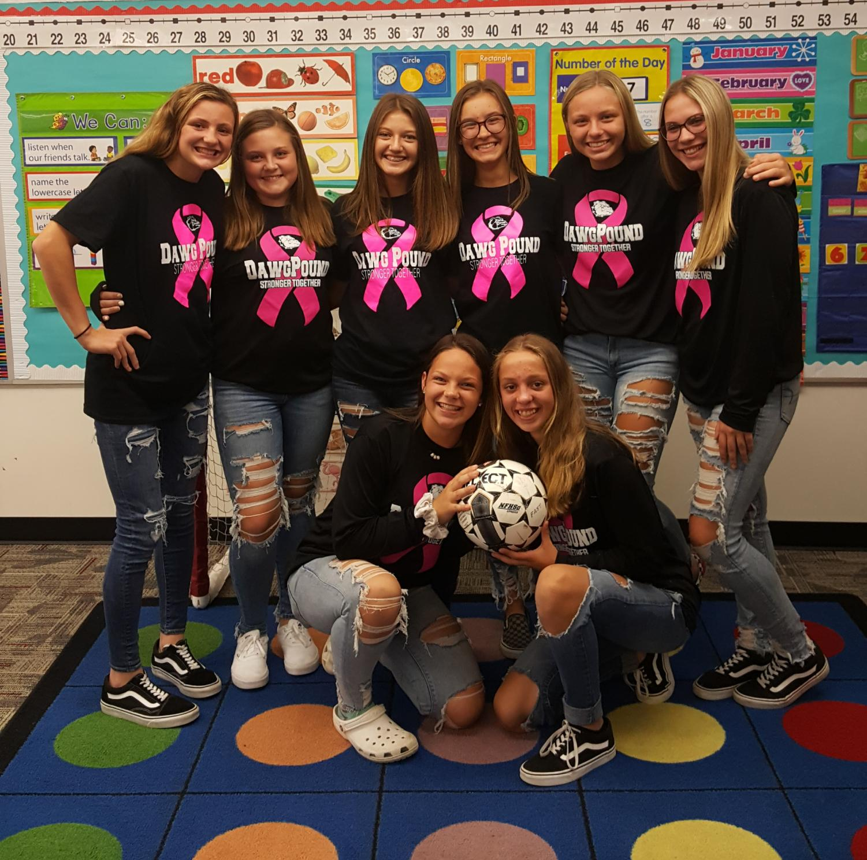 Eighth-grade girls soccer team together in a kindergarten classroom.