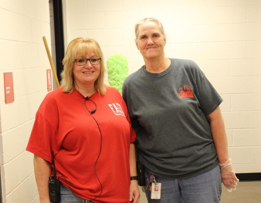 Ms. Blinn and  Ms. Nancey getting ready to clean the elementary.