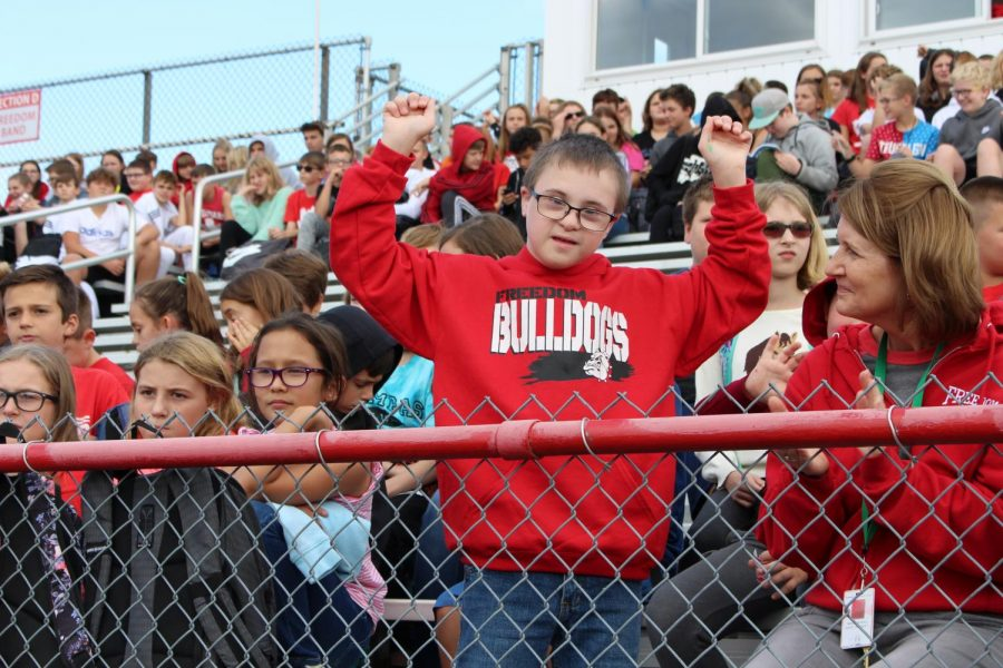 Cayden Signorelli, sixth grader, cheers on the athletes at the fall sports assembly on Oct 4.