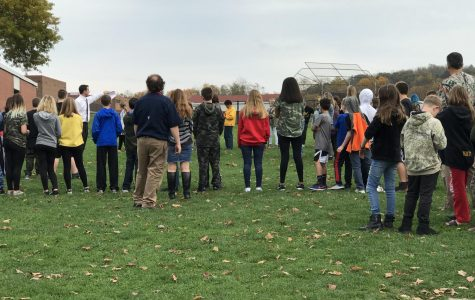 Fifth and sixth grade students use the new plan to exit the building and wait by the softball field on Oct. 30 during a fire drill.