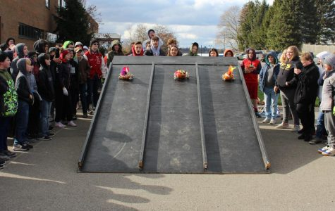 The students race their pumpkin derby cars against each other on the third and final day of Fall Fest