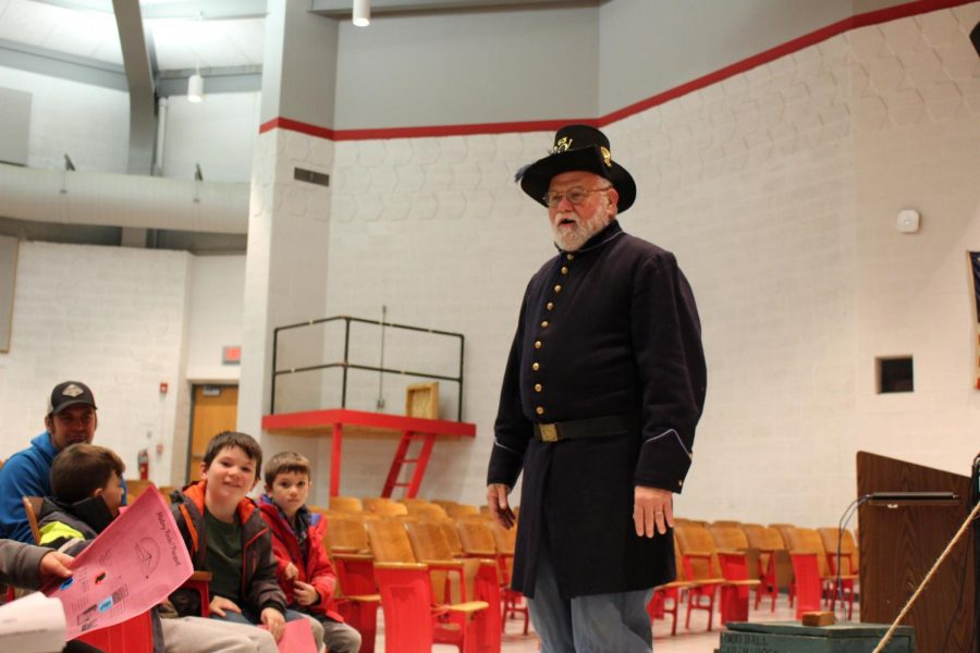 Mr. Kappas wears his historical uniform in front of students at History Night.