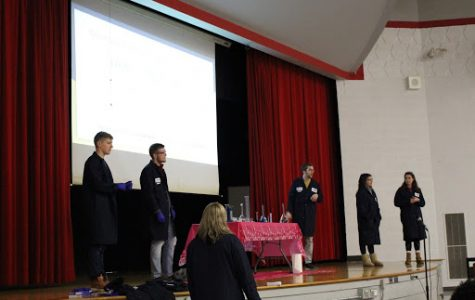 Kristy Sturgess and her team of Pitt graduates give chemistry presentation to the sixth grade.