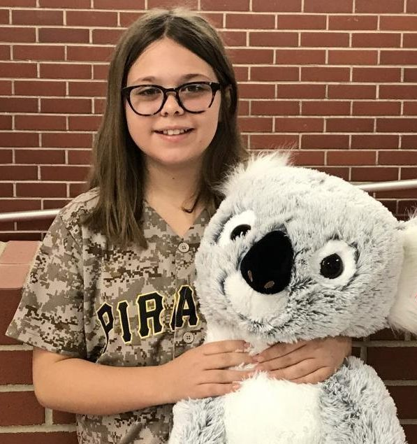Alexa McGhee, fifth grade student, won the stuffed koala that was being raffled for the fires.