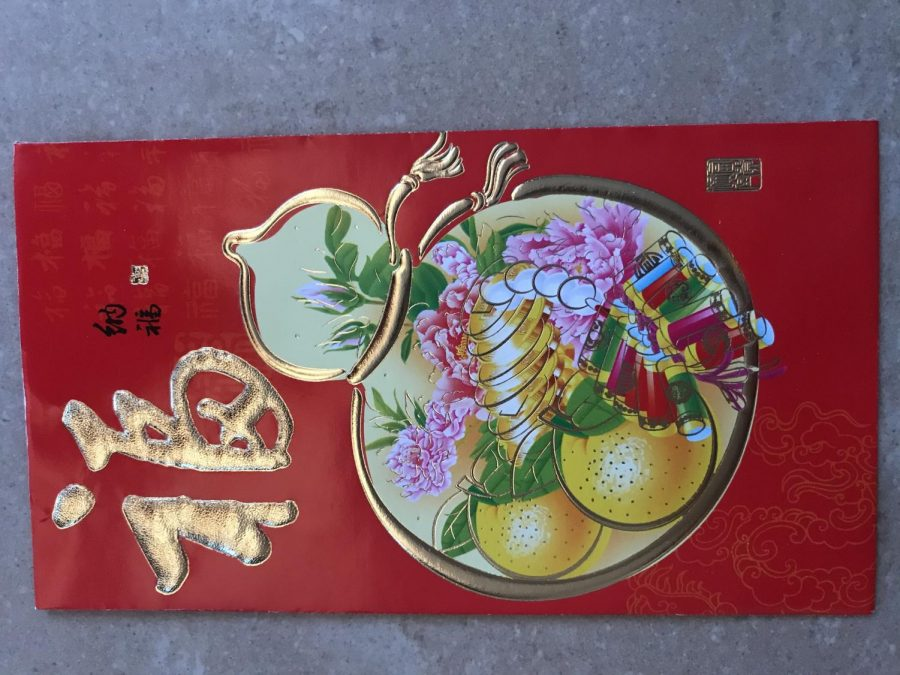 Hongbao, the red envelope, is given to children by their parents on Chinese New Year.