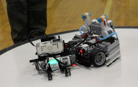 The robot of Logan Larrick and Beau Dethomas, pushes another  school's robot