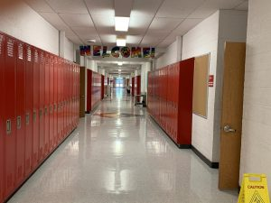 Hallways are empty and                    classrooms are quiet as students are not in school. Most teachers say that it is awkward because there are no kids there.