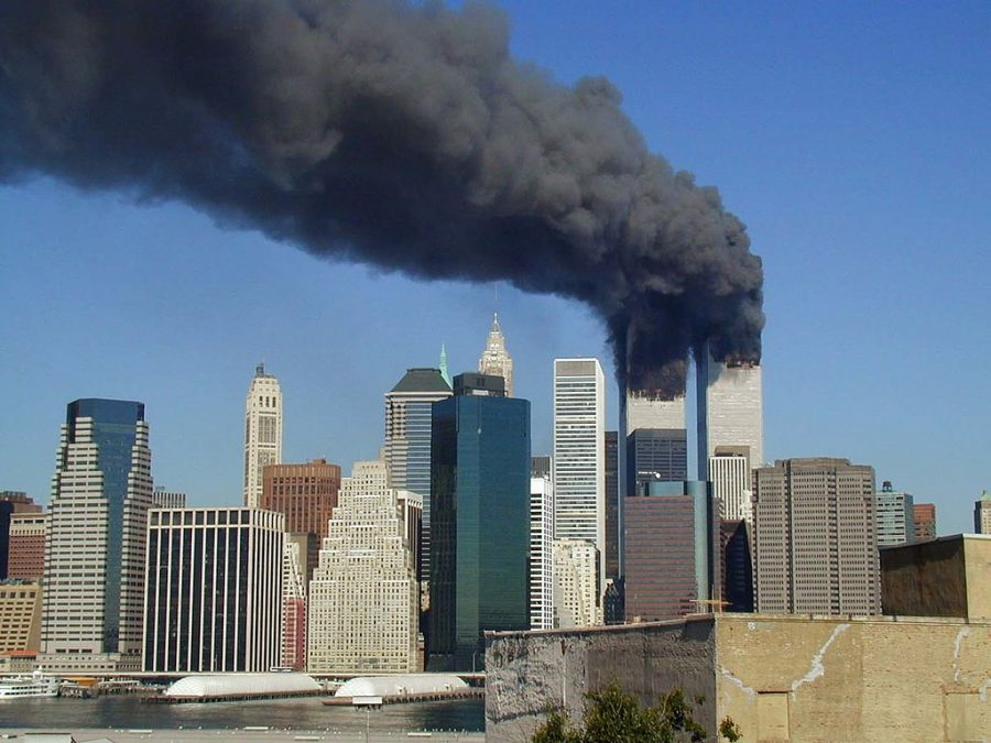 Plumes+of+smoke+billow+from+the+World+Trade+Center+towers+in+Lower+Manhattan%2C+New+York+City%2C+after+a+Boeing+767+hits+each+tower+during+the+September+11+attacks.