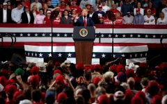 President Trump speaks at a rally without a mask in early February.