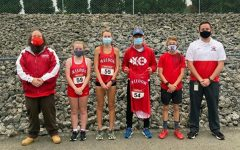 The whole cross country team poses with coaches Gregg and Fitzpatrick after the meet at Neshannock on Sept. 29.