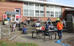 Mrs. Ging's sixth grade honors math class carves, guts, and counts seeds while socially distanced in the courtyard classroom.