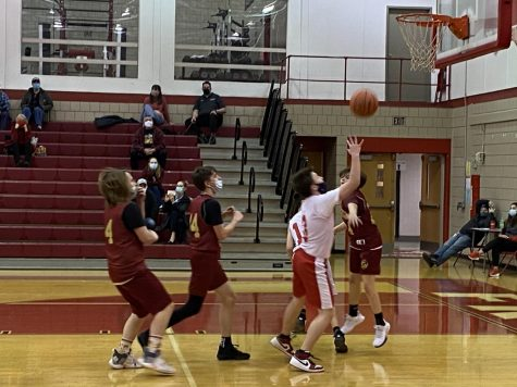 Garrett Drutarosky weaves through New Brighton defenders to shoot a layup for the Bulldogs on Jan. 21.
