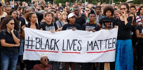A group of people gather to support the Black Lives Matter movement in Berlin