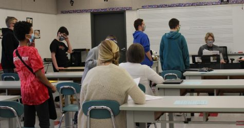 Mrs. Newman's 7th and 8th graders singing a song during chorus in the music room.