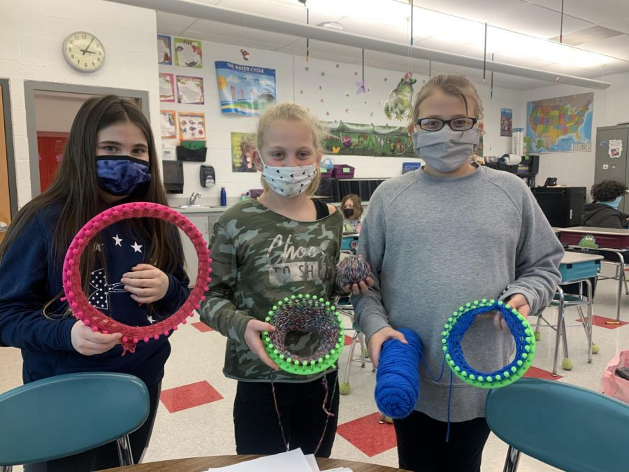 4th graders  ( From left to right ) Chloe Hillard, Sophia Bruce, and Avary Cooper work on their hats and scarves during their free time.
