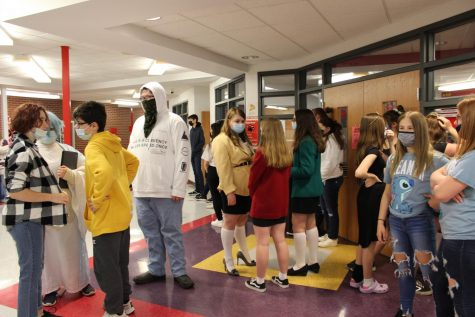 Seventh and eighth graders lined up outside the library on Thursday waiting for their picture to be taken.