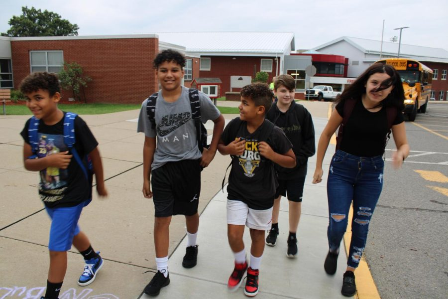 Students arrive at school on the morning of Aug. 31.