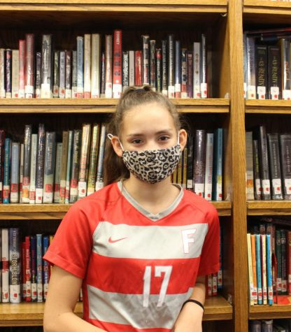 Kendall Climo, seventh grader, in the library wearing a mask on Sept. 15, 2021.